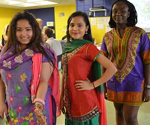 Girls dressed in attire to reflect their culture
