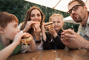 Image of a family eating at a restaurant.